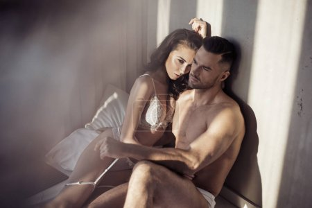 Sensual couple relaxing in an apartment