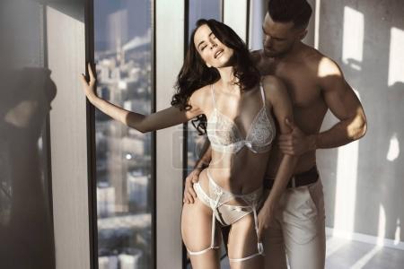 Handsome man seducing his sensual wife