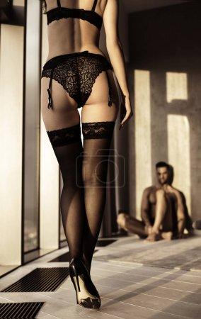 Tempting lady seducing her husband