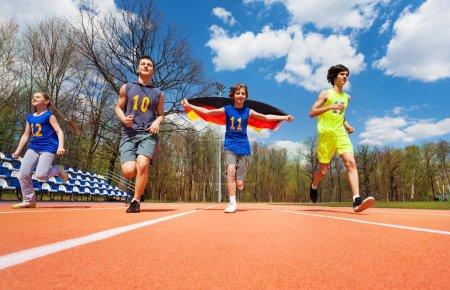 Teenage athletes with German flag