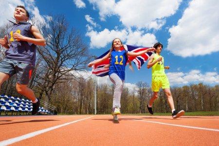 teenage sprinters with British flag