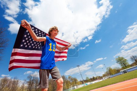 Teenage boy with flag of USA