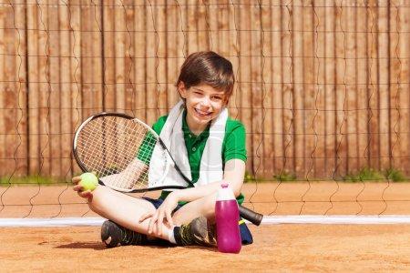 Boy having rest after tennis match
