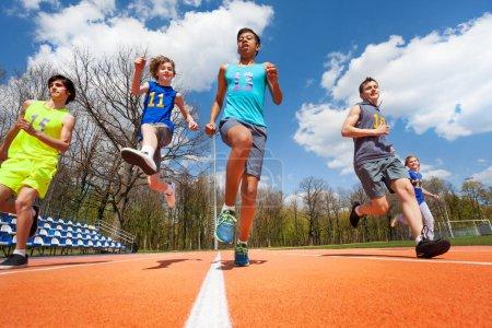 Photo for Teenage athletes having fun on racetrack - Royalty Free Image