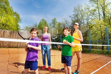 Family preparing to start tennis set