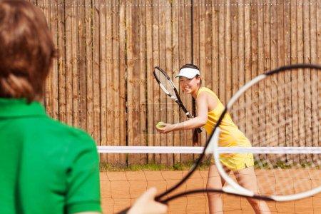 Tennis players playing match