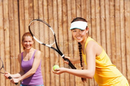 Photo for Portrait of double tennis partners starting set - Royalty Free Image