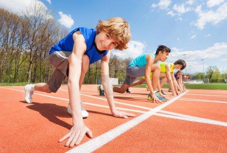 Athletes preparing to start running