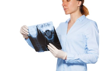 female doctor holding x-ray scan