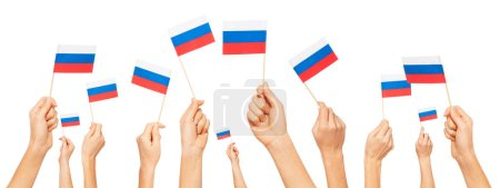 Hands holding flags of Russian Federation