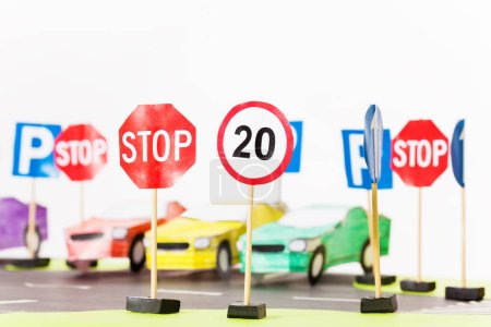 Photo for Handmade paper maquette traffic on roads with crosswalks, signs, parking and paper toy cars - Royalty Free Image