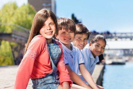 kids sitting on embankment