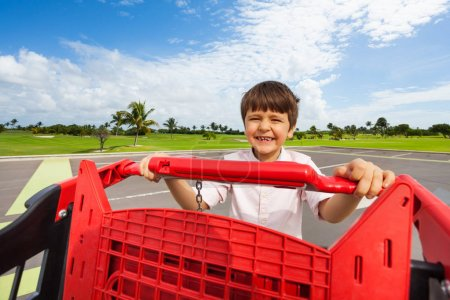 boy with plastic shopping cart