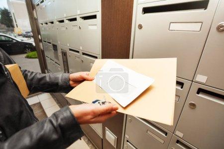 woman hands holding envelopes