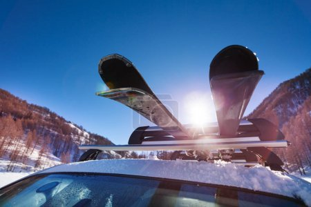 car with skis on roof rails