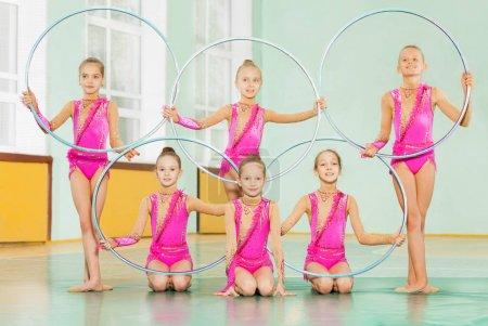 girls gymnasts training in gym