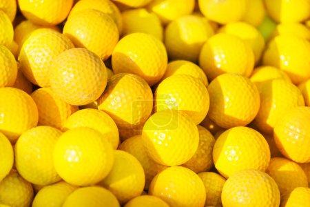 Pile of yellow golf balls