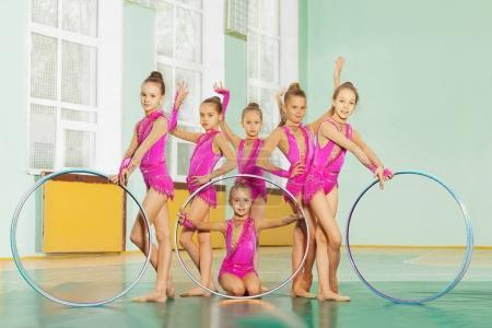 girls in pink leotards with hoops