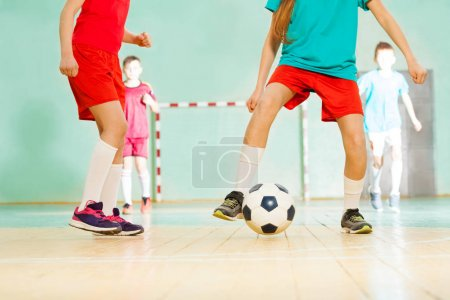 preteen football players training