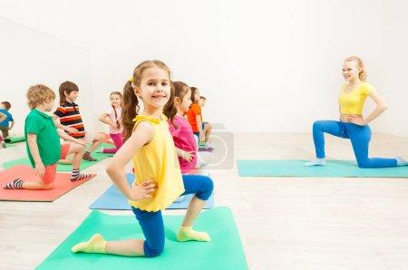 happy kids practicing gymnastic
