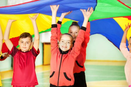 boy and girls playing parachute games