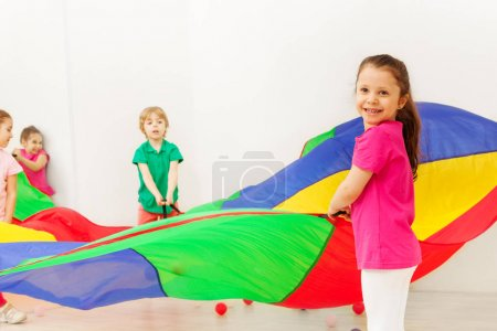 girls and boys with parachute