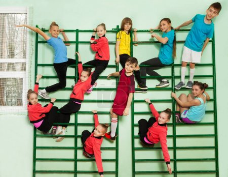 boys and girls on bars of wall-mounted