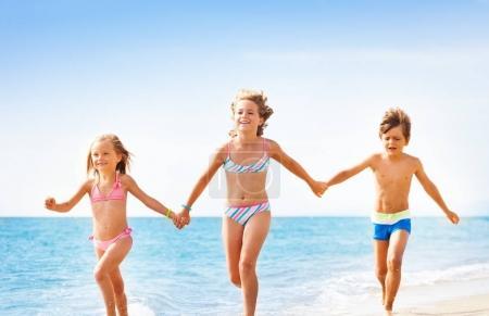 kids running at tropical beach