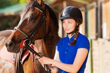 Horsewoman with purebred bay horse
