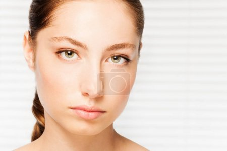 Photo for Close-up portrait of dark-haired woman with clean skin face and looking calm - Royalty Free Image