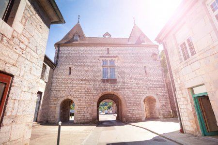 Facade of the medieval building with archways in Besancon, France