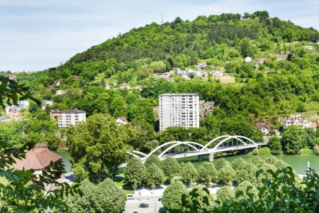 Beautiful landscape of Besancon with unbraced tied-arch Chardonnet bridge across the Doubs River at sunny day