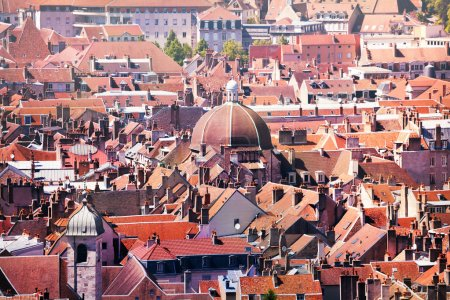 Beautiful view of red tiled roofs of Besancon from above at sunny day, France, Europe