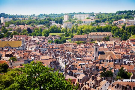 Beautiful cityscape of Besancon red tiled roofs of old buildings at sunny day, France, Europe