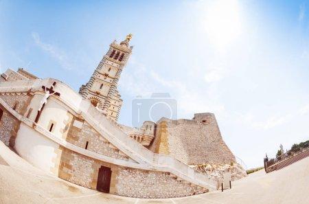 Fish-eye picture of Basilica Notre Dame de la Garde against blue sky, Marseille, France