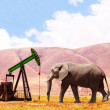 Concept image of the elephant and oil tower in the...