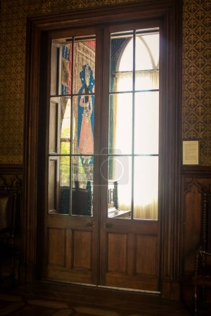 Vorontsov palace room interior with picture on wall through glass corridor door Crimea Ukraine