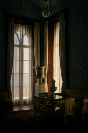 Vorontsov palace interior room with white grand piano near lit window with curtains Crimea Ukraine