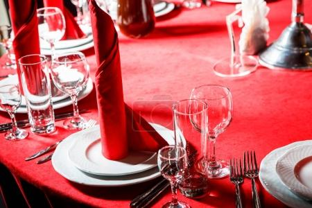 served table in red with web imitation in gothic style catering service banquet