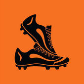 Pair soccer of boots  icon Orange background with black Vector illustration