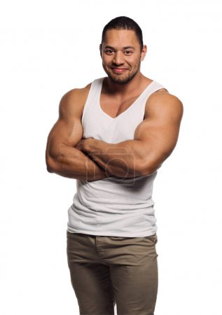 Photo for Muscular build young man isolated on white background - Royalty Free Image