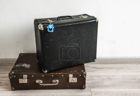 Rustic leather vintage suitcases and old two keys ...