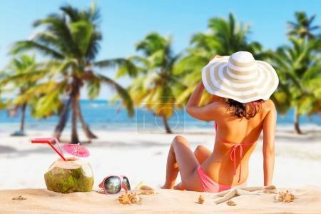 Photo for Beautiful woman in bikini sunbathing at the seaside - Royalty Free Image
