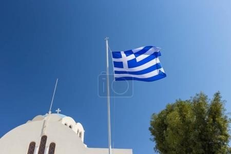Cycladic church with greek flag, Greece
