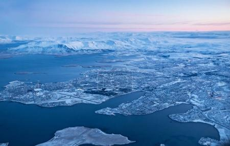 View of Keflavik city in winter through airplane window.