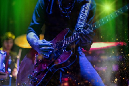 Guitarist playing on electric guitar.