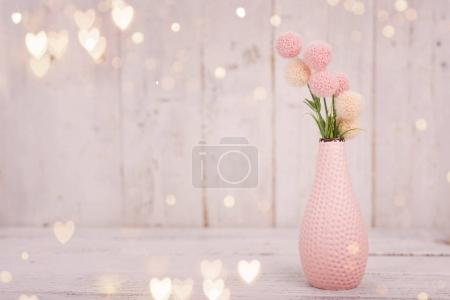 Flowers composition for Valentines, Mothers or Womens Day. Pink flowers on old white wooden background.