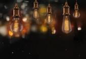 Vintage Edison light bulbs on dark background.