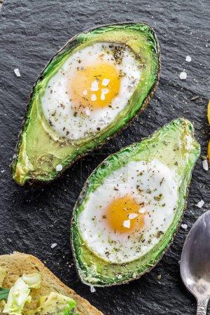 Chicken egg baked in avocado. Delicious meal.