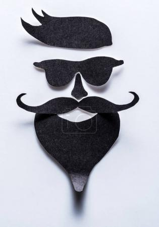 Hipster's definicial facial look cut from paper.